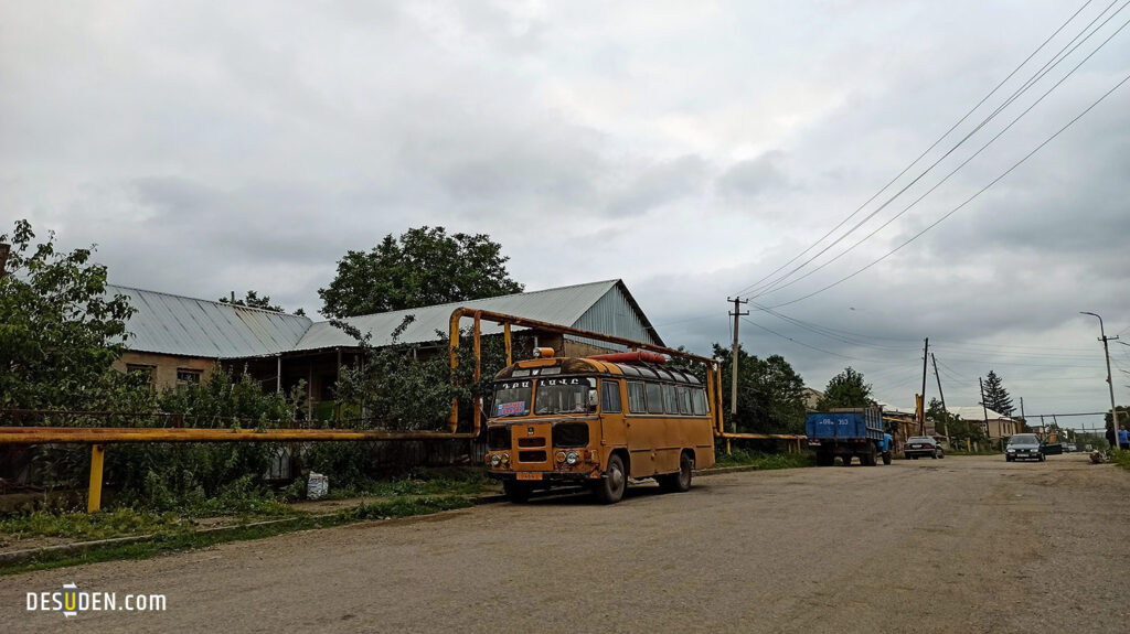Old soviet-times passenger bus in the street of Kurtan village