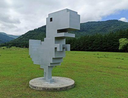 Chrome Dinosaur statue in Gyulagarak, Stepanavan region of Armenia